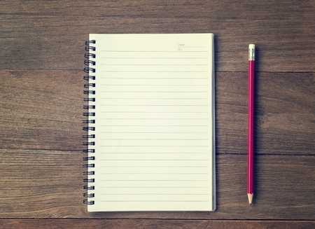 Blank Small notepad  and  pencil on the wooden table. View from above Stock Photo