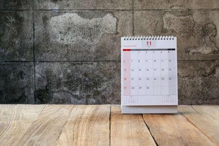 november calendar: November Calendar 2016 and old flower on wood table