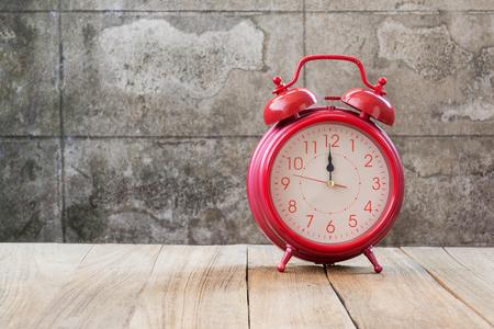 12: retro alarm clock (12 oclock)on wood table