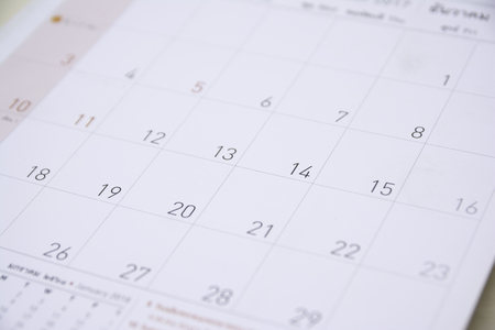 close up calendar on wood table,selective focus Imagens