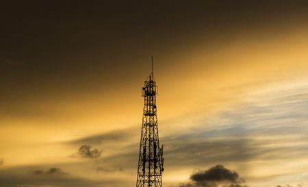 communication tower on sunset sky Stok Fotoğraf