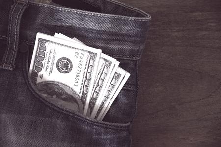 US dollars banknote in Jeans pocket, vintage filter processing Stok Fotoğraf