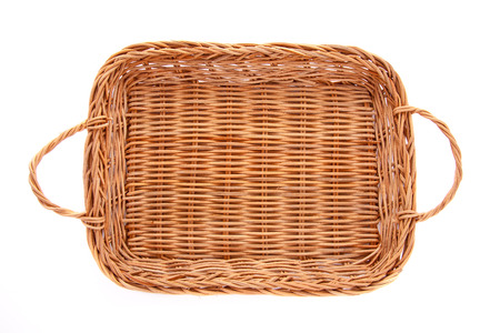 Brown wicker basket isolated on white background, top view