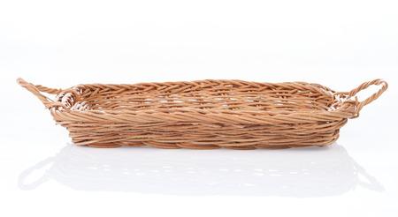 interleaved: Brown wicker basket on white background, side view