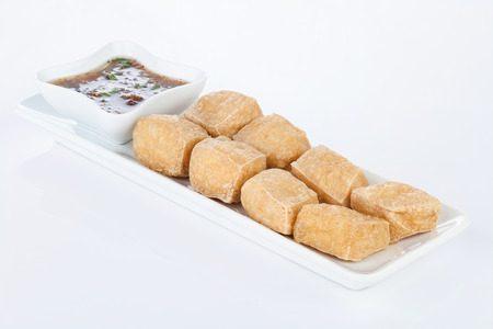 sweet and sour: Deep Fried Tofu on white dish with Sweet & Sour Sauce. Stock Photo