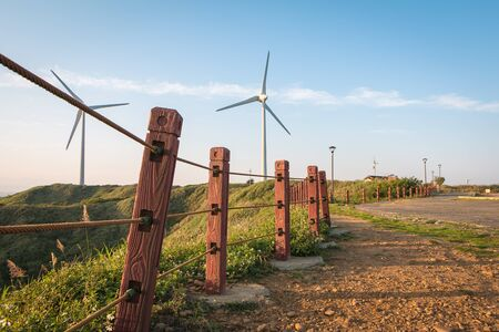 wind force wheel: Walk way to power generation wind turbine Stock Photo