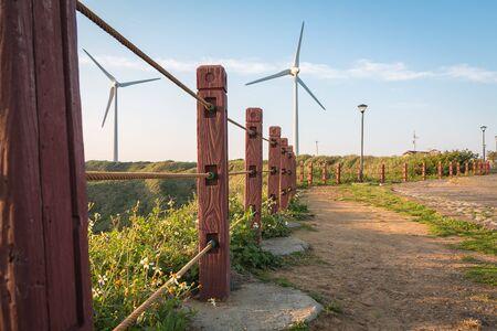 wind force wheel: Walk way to power generation wind turbine Stock Photo