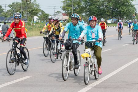 suburbia: SURATTHANI, THAILAND  JUN 21 : Bike tourism campaign for traveller by The Tourism Authority of Thailand TAT. Jun 21, 2015 Chaiya, Suratthani Thailand.