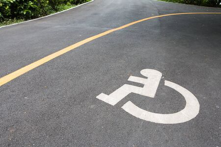Way of wheel chair in public park Stock Photo