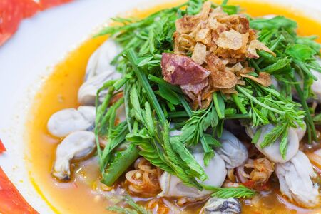 Spicy Oysters Salad with Young Tamarind Leafs Stock Photo