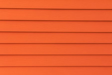 artificial: Texture of orange artificial wood wall