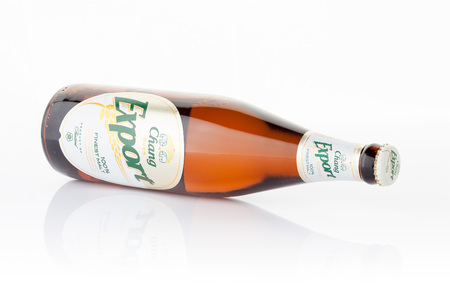 alcoholic beverage: BANGKOK, THAILAND -SEPTEMBER 23, 2015: Chang Beer Export on white background produced by Thai Beverage Public co.ltd, Thai people like to drink because cheap and soft flavor.