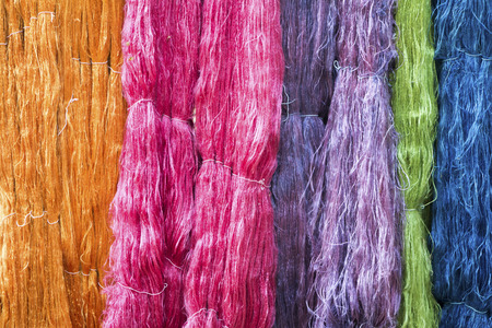 background of silk backgrounds: Colorful raw silk thread in the silk farm
