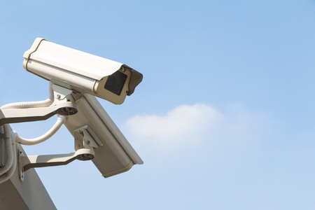detects: Security camera detects the movement on sky background watch right Stock Photo