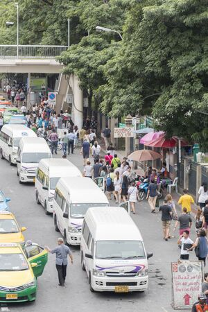 largest: Bangkok, Thailand - November 07, 2015: van taxis, taxis and people crowd on street at jatuchak market. Jatujak is the largest market in Thailand and the worlds largest weekend market.