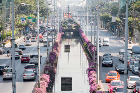 working hour: Bangkok, Thailand - December 21, 2015: Traffic at sathorn road in the morning as working hour, sathorn business district is the center of bangkok.