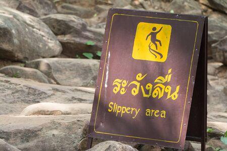 Sign showing slippery area wet floor