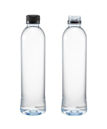Two plastic bottle of water close and open caps isolated on a white background