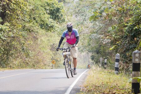 long weekend: Nakornratchasima, Thailand - February 20, 2016: Activities of Mountain Bikers challenging themselves uphill on a Long Weekend Sporting and Fitness at Khao yai national park. Editorial