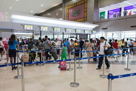 icc: Bangkok, Thailand - May 14, 2016: Unidentified people check in for Thai Lion Air flights at Don Mueang International Airport Terminal 2.