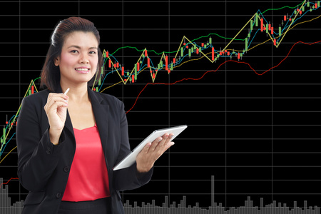 business, technology, internet and stock market concept with copy space - friendly young smiling businesswoman with tablet