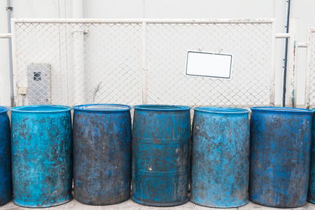 Blue plastic containers in a row for separate garbage collection. Archivio Fotografico