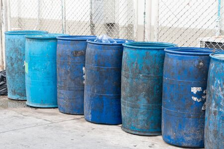 Blue plastic containers in a row for separate garbage collection. Stock Photo