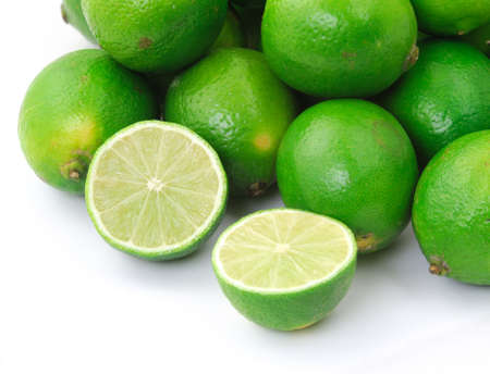 close-up of half lime with wole limes