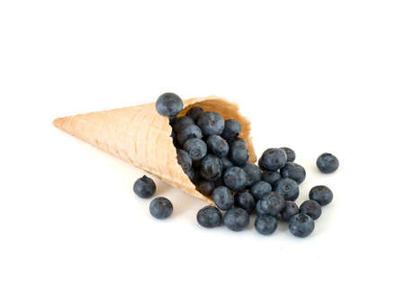 isolated cornet with fresh blueberries on white background