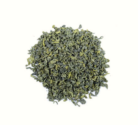 dried green tea leaves on white, top view Banco de Imagens