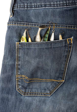 some lures and baits in a jeans pocket