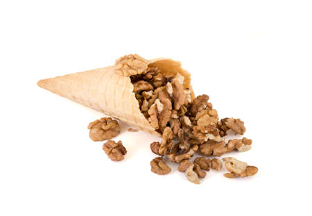 isolated cornet with fresh walnut on white background Banco de Imagens
