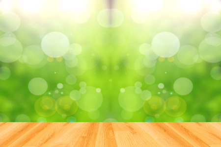 wood floor and abstract green bokeh background Stock Photo