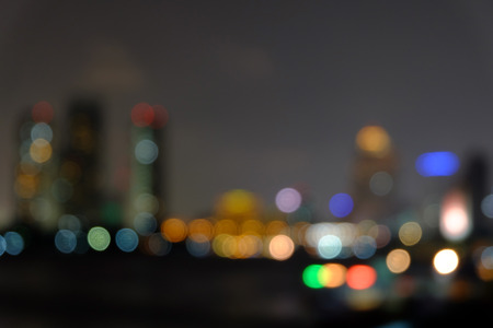 light  bokeh blurred abstract background of bangkok cityscape and Chao Phraya River view at night Stock Photo