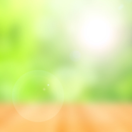 blurred abstract green bokeh background with flare Stock Photo