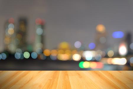 wood floor and abstract blurred city lightBangkok Thailand