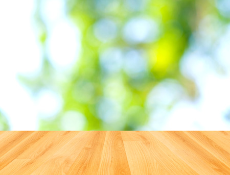 wood floor and green bokeh nature background