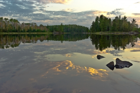 minnesota woods: Clouds reflected on a lake in the Boundary Waters Canoe Area Wildernes in Minnesota  Stock Photo