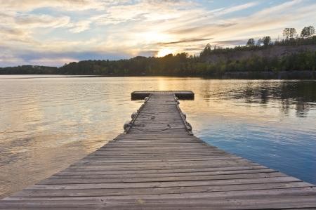 minnesota woods: Boat dock on White Iron Lake at Sunset  Stock Photo