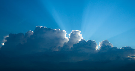 Rays of light shining through clouds, suitable for background