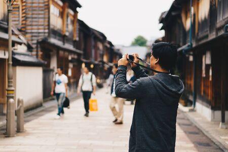 Asian male tourist taking photo at Higashi Chaya District, Kanazawa, Japan. Stok Fotoğraf