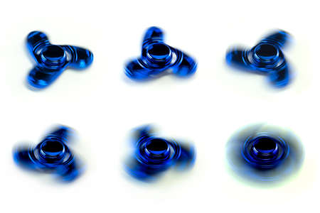 Blue Fidget Spinners spinning at various speed, on white background.