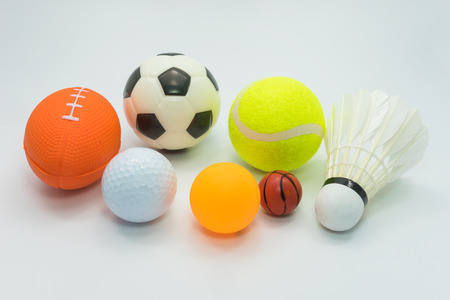Sports concept : Various sports balls including small Soccer ball, small Rugby ball, Golf ball, Tennis ball, Table tennis ball, Tiny basketball, Badminton shuttle cock - all on white background.