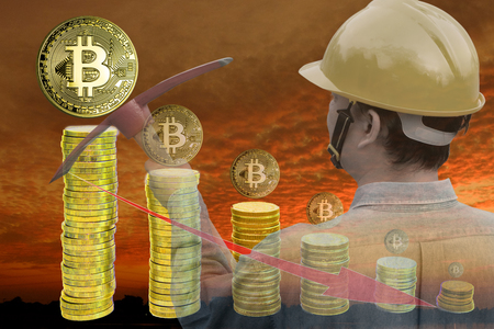 Bitcoin mining concept : Miner holding pickaxes on sunset background with stack of coins. Bitcoins which getting smaller, implying lower price. Multiple exposure technique.