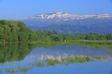 imperial: Imperial Lake and volcano Akita-komagatake Stock Photo