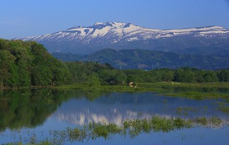 Imperial Lake and volcano Akita-komagatake Stock Photo