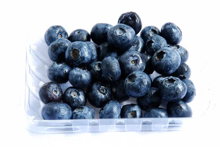 A view of blueberries in a basket on white background photo