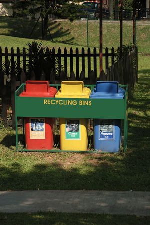 neatness: View of three recyling bins in a garden