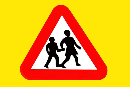 road traffic sign board for nearby school photo