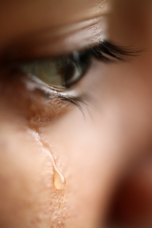emotional: Macro view of an eye with tears Stock Photo